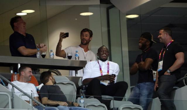 Athletics - Gold Coast 2018 Commonwealth Games - Carrara Stadium - Gold Coast, Australia - April 12, 2018. Actor Chris Hemsworth and former Jamaican sprinter Usain Bolt attend the events. REUTERS/Paul Childs