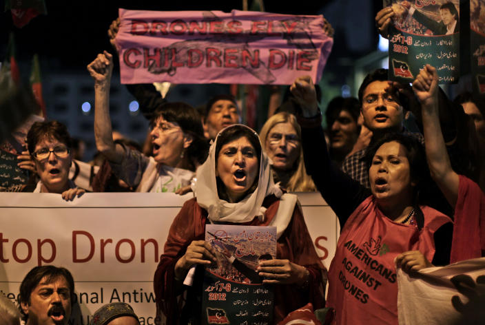 "Pakistanis and American citizens hold banners and chant slogans against drone attacks in Pakistani tribal belt, in Islamabad, Pakistan, Friday, Oct. 5, 2012. A group of American anti-war activists are in Pakistan with plans to join a ""march"" into the country's tribal belt to protest U.S. drone strikes in the rugged northwest territory. Their presence has energized some Pakistanis, but it also has added to concerns that Islamist militants will target the weekend event. (AP Photo/Muhammed Muheisen)"