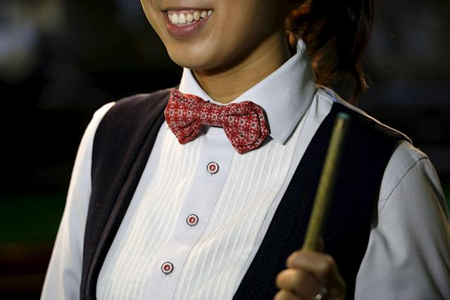 Ng On-yee, 25, 2015 Ladies World Snooker Championship winner, smiles during an interview in Hong Kong, China January 27, 2016. A decade after taking up the sport because she liked her father's outfit, Hong Kong's Ng On Yee finds herself on the brink of snooker history as she embarks on a mission to reach the main draw of the men's world championships. Picture taken January 27, 2016. REUTERS/Bobby Yip