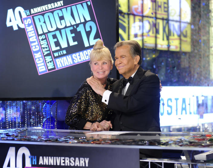 """In this photo provided by ABC, broadcaster Dick Clark is joined by his wife Kari Clark, during the 40th Anniversary of """"Dick Clark New Year's Rockin' Eve, Sunday, Jan. 1, 2012 on Times Square in New York. Clark died of a heart attack in California on Wednesday, April 18, 2012. He was 82. (AP Photo/ABC, Ida Mae Astute)"""