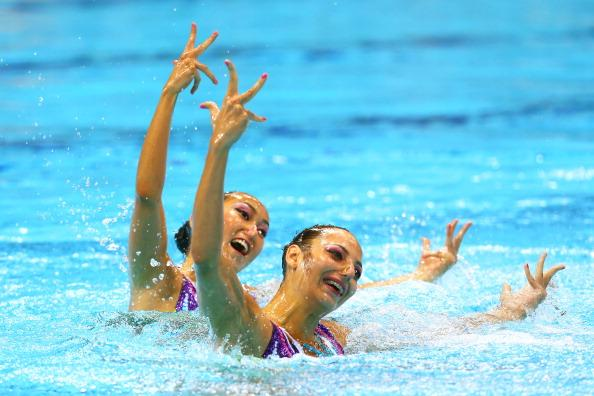 LONDON, ENGLAND - AUGUST 05:  Anna Kulkin and Aigerim Zhexembinova of Kazakhstan compete in the Women's Duets Synchronised Swimming Technical Routine on Day 9 of the London 2012 Olympic Games at the Aquatics Centre  on August 5, 2012 in London, England.  (Photo by Clive Rose/Getty Images)