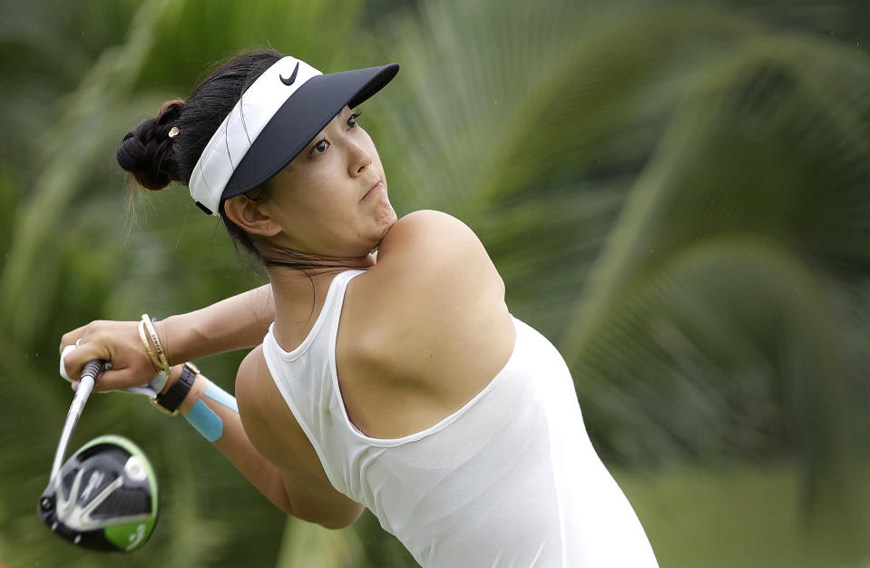 FILE - In this March 4, 2017, file photo, Michelle Wie of the United States tees off on the 2nd hole during the HSBC Women's Champions golf tournament at Sentosa Golf Club's Tanjong course in Singapore. The LPGA Tour completes its four-week swing through Australia and Asia with a healthy Wie defending her title at the 2019 HSBC Womens World Championship at the course. (AP Photo/Wong Maye-E, File)