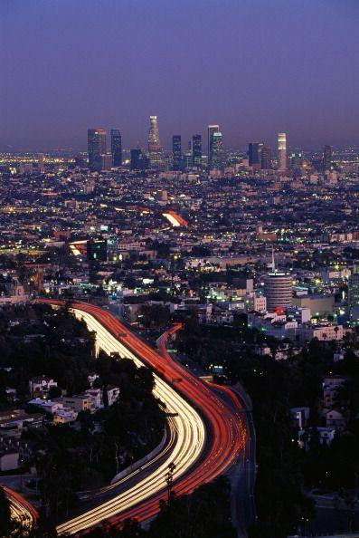 <p>It's pretty cool to see the city's freeways light up. The white stream of light is coming from people's headlights and the red are from taillights (Who knew traffic could be so beautiful?). </p>