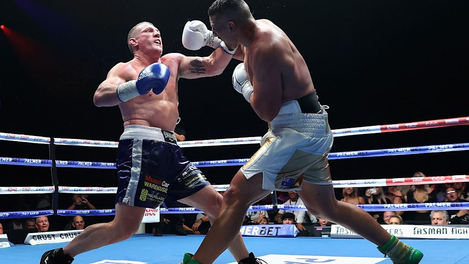 Justis Huni, pictured here knocking Paul Gallen to the canvas in their Australian heavyweight title fight.