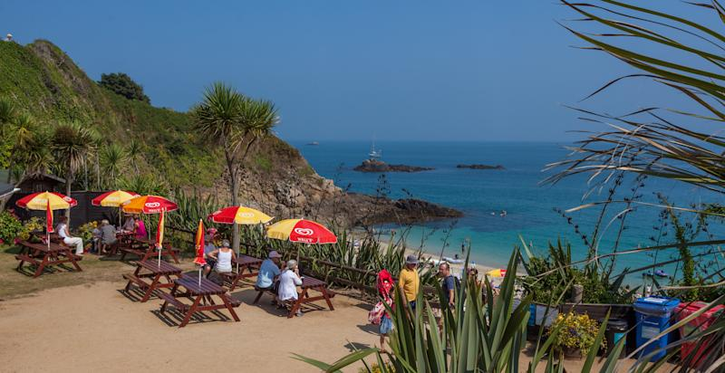 Stop for a bite and a spectacular view at the Belvoir Beach kiosk in Herm.