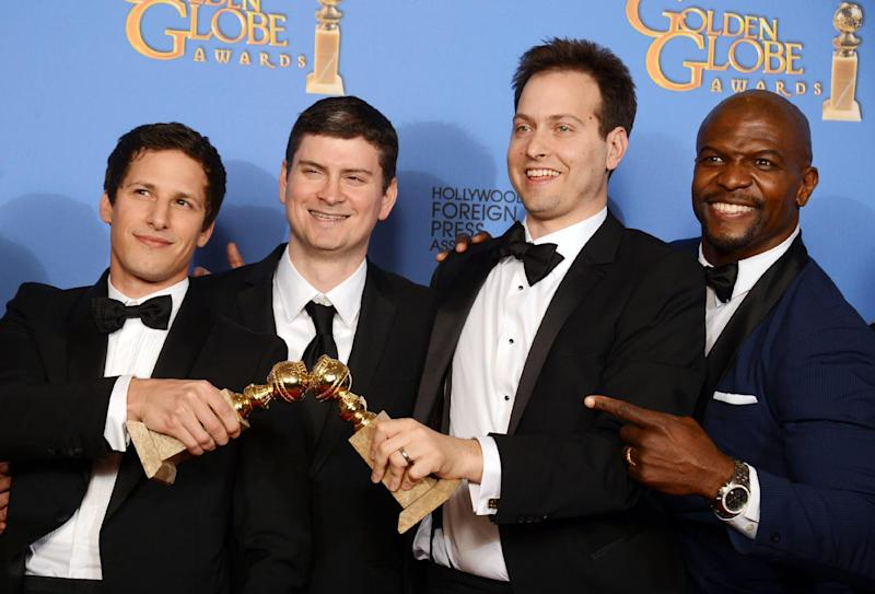 """From left, Andy Samberg, Michael Schur, Dan Goor and Terry Crews pose in the press room with the award for best television series - comedy or musical for """"Brooklyn Nine - Nine"""" at the 71st annual Golden Globe Awards at the Beverly Hilton Hotel on Sunday, Jan. 12, 2014, in Beverly Hills, Calif. (Photo by Jordan Strauss/Invision/AP)"""