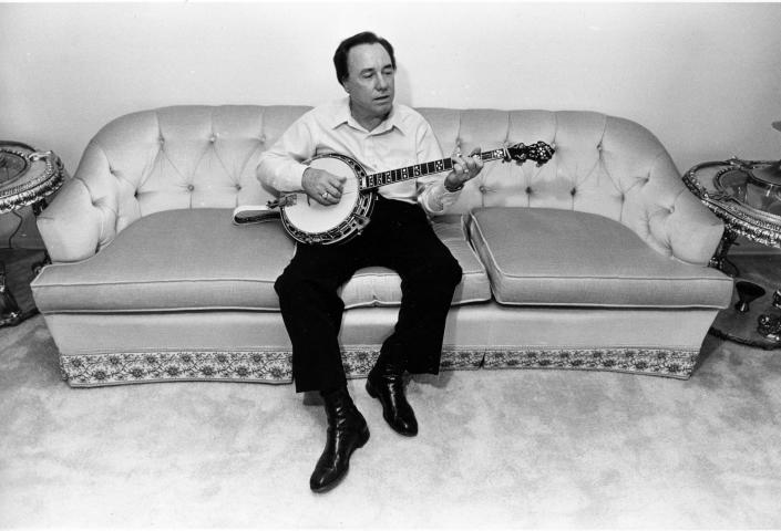 FILE - In this photo taken Aug. 9, 1982 file photo, bluegrass legend and banjo pioneer Earl Scruggs plays his banjo. Scruggs' son Gary said his father passed away Wednesday morning, March 28, 2012 at a Nashville, Tenn., hospital of natural causes. He was 88. (AP Photo/Mark Humphrey, File)