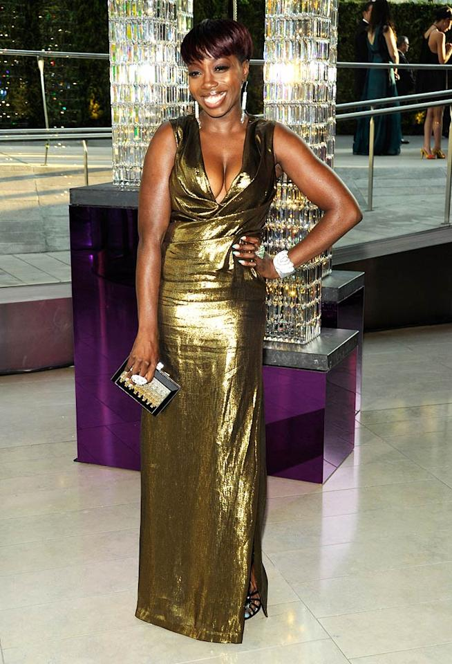 "Singer Estelle made a statement at the event in a shimmery gold gown with a slit up the side. Kevin Mazur/<a href=""http://www.wireimage.com"" target=""new"">WireImage.com</a> - June 6, 2011"