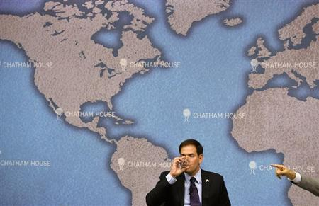 Rubio drinks as he prepares to answer questions after delivering a speech at Chatham House in London