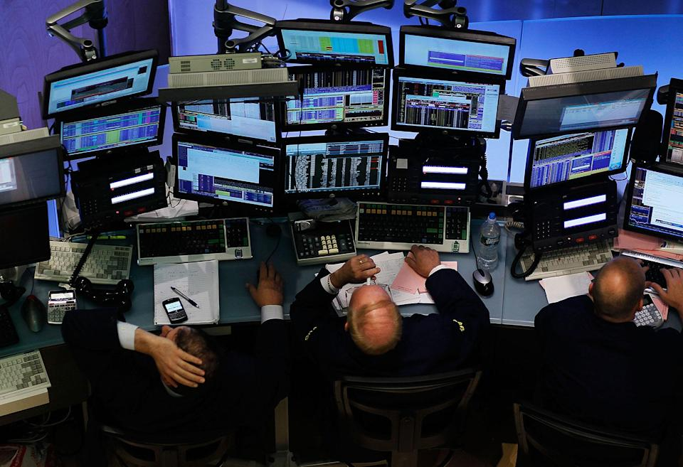 <p>Financial professionals work at stations on the floor of the New York Stock Exchange in the middle of the trading day May 20, 2010 in New York City. Stocks dropped today over concerns that debt involved with Europe's bailout plan could slow a global recovery. (Photo by Chris Hondros/Getty Images) </p>