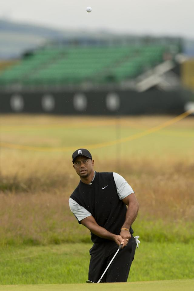 Tiger Woods of the US plays a shot to the 16th green during a practice round at Royal Liverpool Golf Club prior to the start of the British Open Golf Championship, in Hoylake, England, Saturday, July 12, 2014. The 2014 Open Championship starts on Thursday, July 17. (AP Photo/Jon Super)