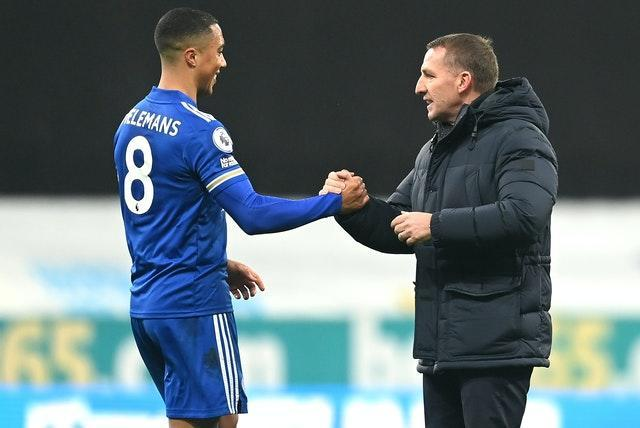 Youri Tielemans, left, and Brendan Rodgers celebrate Leicester's 2-1 win at Newcastle