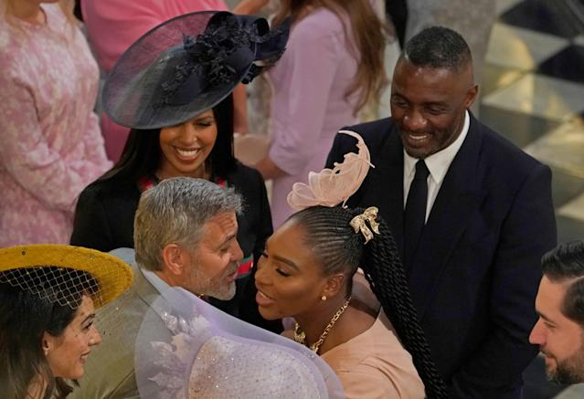 George Clooney greets Serena Williams as Idris Elba and Sabrina Dhowre look on in St George's Chapel at Windsor Castle for the wedding of Prince Harry and Meghan Markle Windsor, Britain May 19, 2018. Owen Humphreys/Pool via REUTERS
