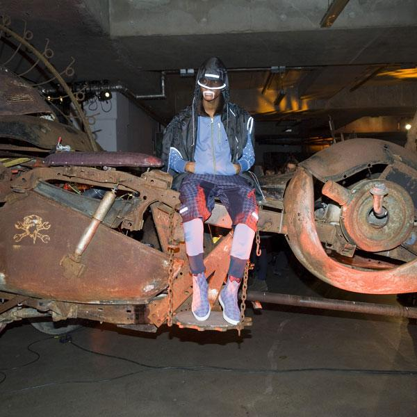 <b>Model, Vivienne Westwood</b><br><br>The Vivienne Westwood AW13 presentation saw models decked out in bomber jackets and sports shoes seated on old vehicles.