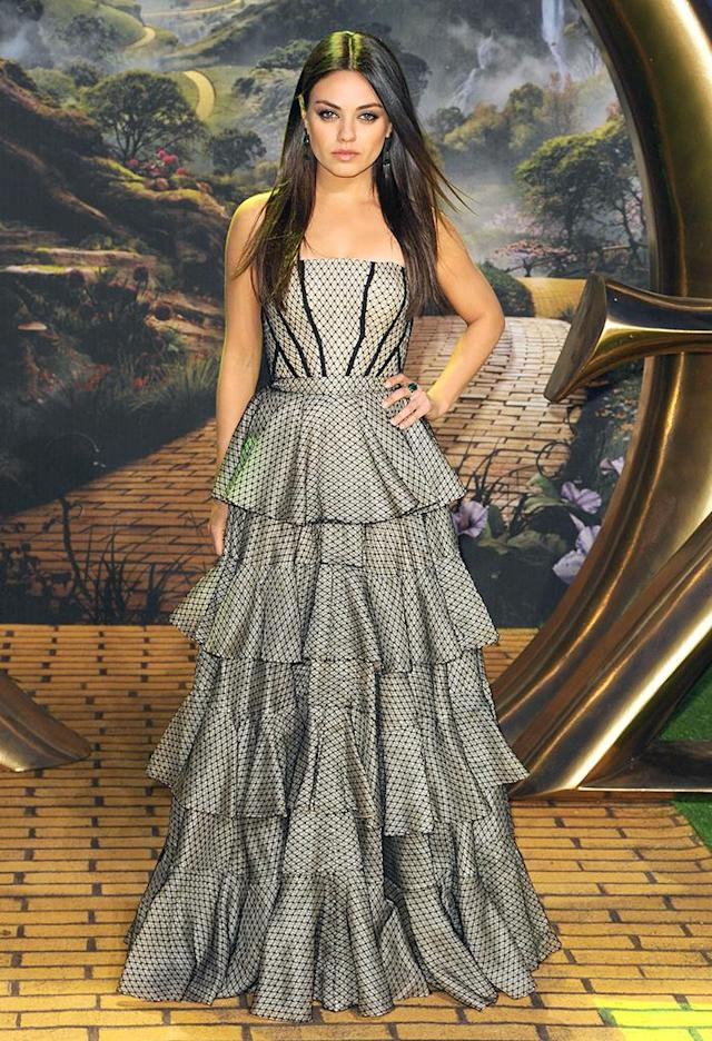 "Mila Kunis working it in a tiered, strapless Alexander McQueen stunner at the London premiere of ""Oz the Great and Powerful"" ... 'nuff said! (2/28/2013)"