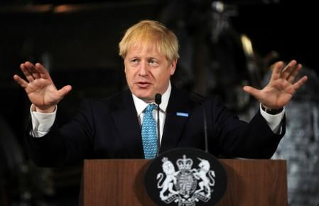 Britain's Prime Minister Boris Johnson gestures during a speech on domestic priorities at the Science and Industry Museum in Manchester