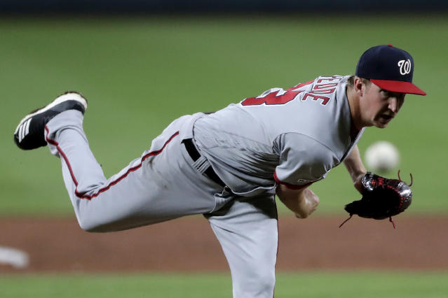 Washington Nationals starting pitcher Erick Fedde delivers to a Baltimore Orioles batter during the third inning of a baseball game, Wednesday, July 17, 2019, in Baltimore. (AP Photo/Julio Cortez)