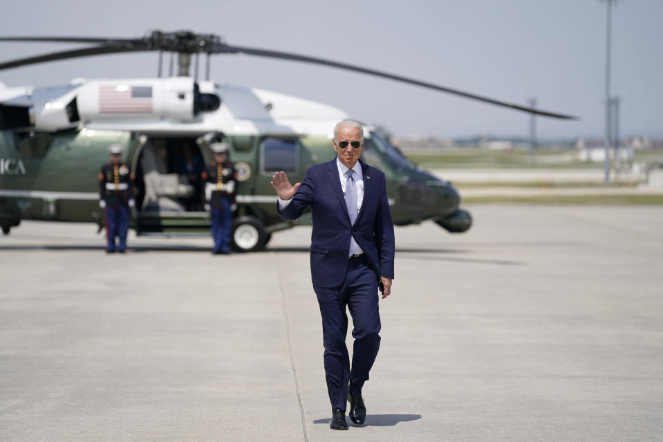 President Joe Biden waves before boarding Air Force One at O'Hare International Airport, Wednesday, July 7, 2021, in Chicago. (AP Photo/Evan Vucci)
