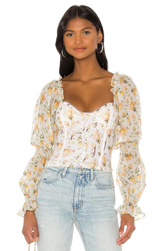 "<p>This <product href=""https://www.revolve.com/v-chapman-x-revolve-jasmine-top/dp/VCHP-WS19/?d=Womens&amp;page=1&amp;lc=3&amp;itrownum=1&amp;itcurrpage=1&amp;itview=05"" target=""_blank"" class=""ga-track"" data-ga-category=""Related"" data-ga-label=""https://www.revolve.com/v-chapman-x-revolve-jasmine-top/dp/VCHP-WS19/?d=Womens&amp;page=1&amp;lc=3&amp;itrownum=1&amp;itcurrpage=1&amp;itview=05"" data-ga-action=""In-Line Links"">V. Chapman X Revolve Jasmine Top</product> ($235) can be worn on or off the shoulder.</p>"