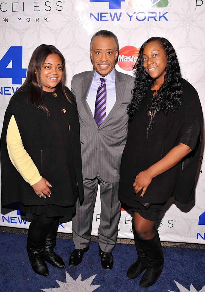 Media staple and MSNBC host Al Sharpton was flanked by his daughters Ashley (left) and Dominique. (11/30/2011)