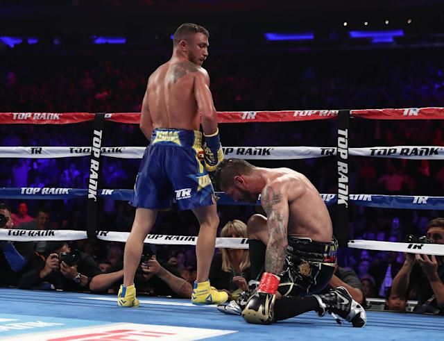Vasiliy Lomachenko knocks down Jorge Linares in the tenth round during their WBA lightweight title fight at Madison Square Garden on May 12, 2018 in New York City. (Getty Images)