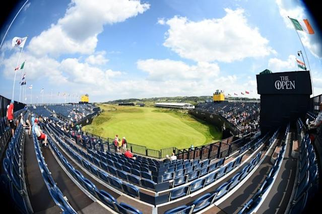 Northern Irish golf fans will pack the grandstand at the 18th green later in the week (AFP Photo/ANDY BUCHANAN )