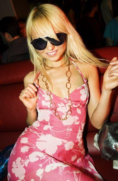 <p>Both Paris Hilton and Elle Woods would endorse this pink patterned halter dress and sunglasses combo. </p>