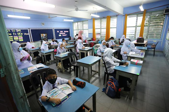 Students attend classes while maintaining safety and health protocols imposed by the Malaysian Ministry of Health in Bandar Baru Bangi, Selangor, Malaysia on July 15.