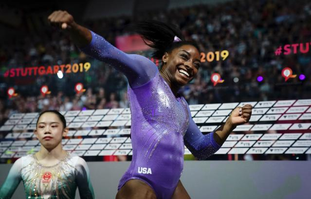 """<a class=""""link rapid-noclick-resp"""" href=""""/olympics/rio-2016/a/1112764/"""" data-ylk=""""slk:Simone Biles"""">Simone Biles</a> was all smiles the moment she found out she'd won gold on the balance beam and become the most decorated gymnast in world championship history. (Getty)"""