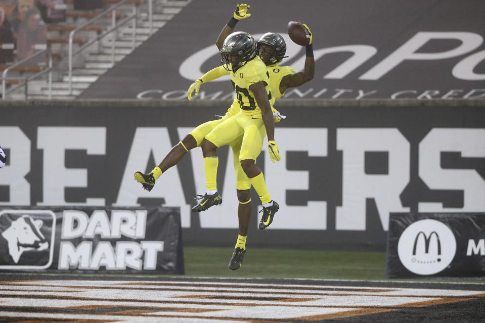 Oregon wide receivers Devon Williams, rear, and Jaylon Redd (30) celebrate Williams' touchdown during the first half of the team's NCAA college football game against Oregon State in Corvallis, Ore., Friday, Nov. 27, 2020. (AP Photo/Amanda Loman)