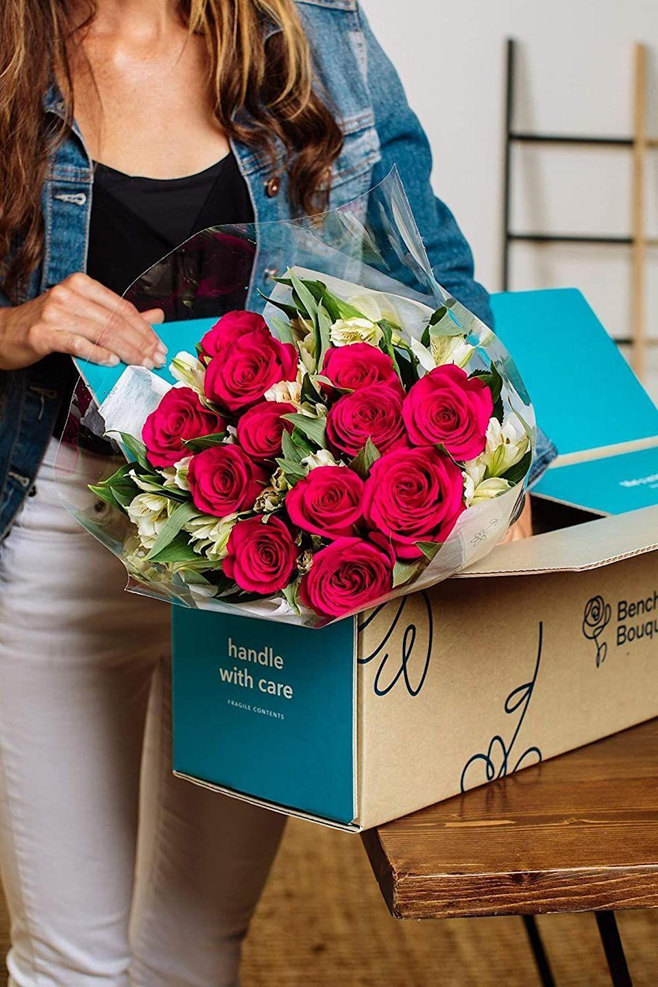 """<p><strong>Benchmark Bouquets</strong></p><p>amazon.com</p><p><strong>$41.61</strong></p><p><a href=""""https://www.amazon.com/dp/B00E3IXY62?tag=syn-yahoo-20&ascsubtag=%5Bartid%7C10055.g.26977276%5Bsrc%7Cyahoo-us"""" rel=""""nofollow noopener"""" target=""""_blank"""" data-ylk=""""slk:Shop Now"""" class=""""link rapid-noclick-resp"""">Shop Now</a></p><p>Yep, you can get flowers from the same place you get your electronics, cleaning supplies, and workout leggings. <strong>Amazon delivers fresh flowers <a href=""""https://www.amazon.com/stores/page/063FC885-5DF2-4D86-BE30-CC8462387F15?tag=syn-yahoo-20&ascsubtag=%5Bartid%7C10055.g.26977276%5Bsrc%7Cyahoo-us"""" rel=""""nofollow noopener"""" target=""""_blank"""" data-ylk=""""slk:from dozens of brands"""" class=""""link rapid-noclick-resp"""">from dozens of brands</a> to your door </strong>— and if you're a Prime member, you can get 'em in two days with free shipping. </p>"""