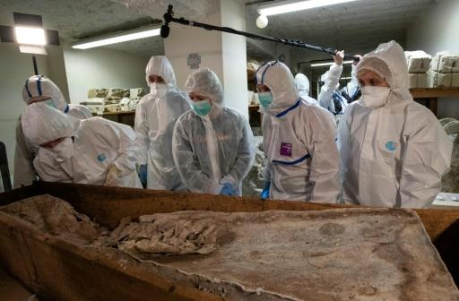 A scientific team examines the grave in the basement of the Musee d'Aquitaine in Bordeaux