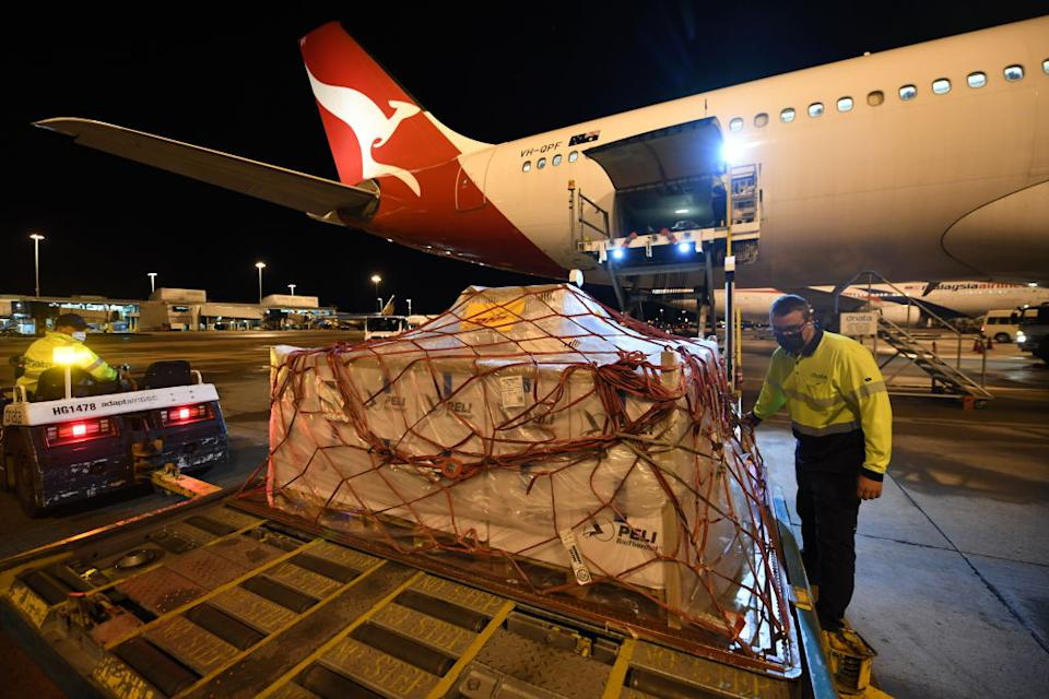 Pallets of vaccines being unloaded off Qantas flight QF110 from Darwin after landing at Kingsford Smith International Airport in Sydney, Australia.