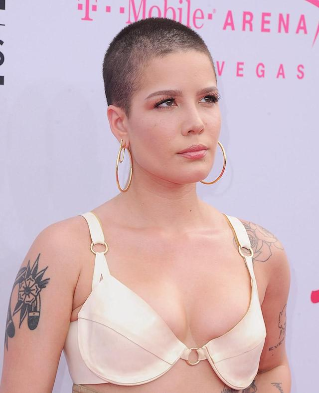 <p>At the 2017 Billboard Music Awards, Halsey gave off edgy chic vibes with her deep brown buzz cut.(Photo: FilmMagic) </p>