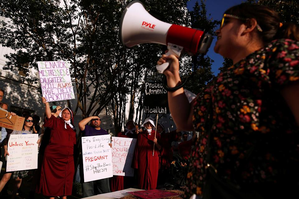 Pro-choice supporters protest in front of the Alabama State House