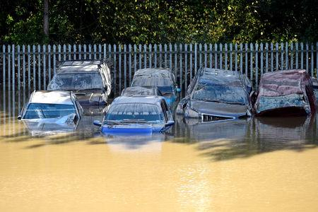 FILE PHOTO: Cars caught in flood water after Storm Callum passed through the town of Carmarthen, west Wales, Britain, October 14, 2018.   REUTERS/Rebecca Naden/File Photo