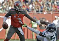 <p>Tampa Bay Buccaneers quarterback Jameis Winston (3) pushes off Seattle Seahawks defensive end Frank Clark (55) during the first quarter of an NFL football game Sunday, Nov. 27, 2016, in Tampa, Fla. (AP Photo/Chris O'Meara) </p>