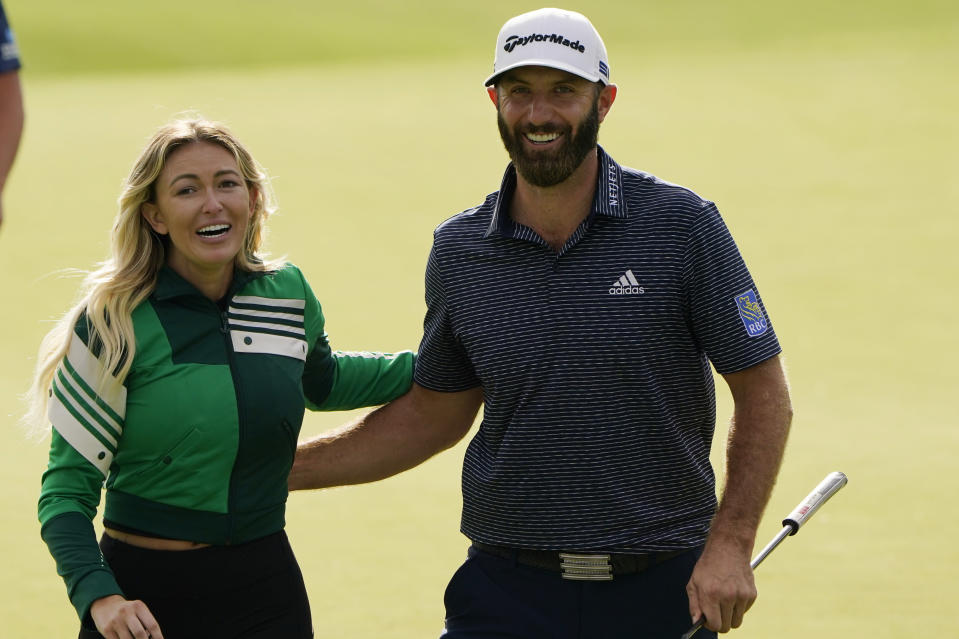 Dustin Johnson walks with Paulina Gretzky after winning the Masters golf tournament Sunday, Nov. 15, 2020, in Augusta, Ga. (AP Photo/Chris Carlson)