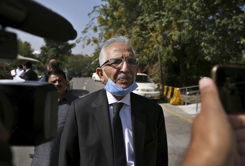 Mahmood Ahmed Sheikh, defense lawyer of British-born Pakistani Ahmed Omar Saeed Sheikh, talks to media outside the Supreme Court after an appeal hearing in the Daniel Pearl's case, in Islamabad, Pakistan, Wednesday, Oct. 7, 2020. Sheikh, who has been on death row over the 2002 killing of U.S. journalist Pearl, will remain in jail for another three months under a government order, a prosecutor told the country's top court Wednesday. (AP Photo/Anjum Naveed)