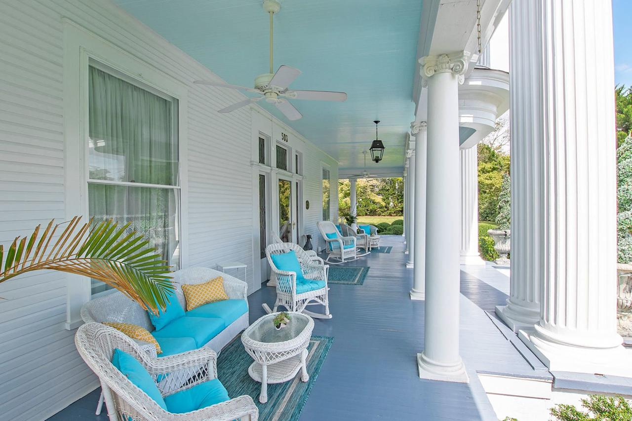 <p>Check out that haint blue! This sprawling front porch has already been spirit-proofed, y'all! </p>