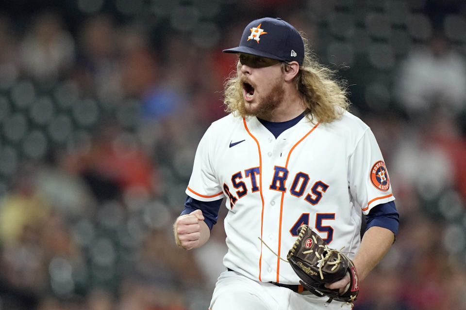 Houston Astros relief pitcher Ryne Stanek reacts after striking out Texas Rangers' Adolis Garcia during the eighth inning of a baseball game Thursday, May 13, 2021, in Houston. (AP Photo/David J. Phillip)