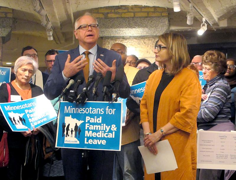 In this Friday, May 3, 2019, photo, Minnesota Gov. Tim Walz speaks from the state Capitol in St. Paul in favor of a proposal for paid family and medical leave on May 3, 2019.
