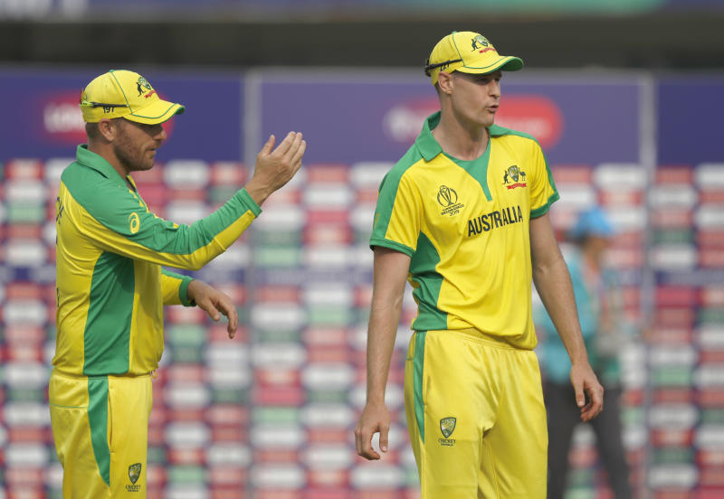 Australia's Jason Behrendorff, right, is asked byAustralia's captain Aaron Finch to lead the team off the field after the end of Cricket World Cup match between England and Australia at Lord's cricket ground in London, Tuesday, June 25, 2019. Australia won by 65 runs with Behrendorff taking 5 wickets. (AP Photo/Alastair Grant)