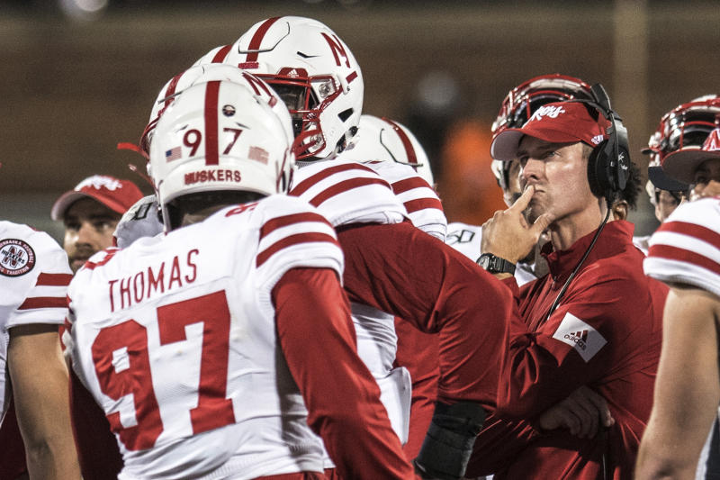 Nebraska head coach Scott Frost stands with his team during a timeout in the first half of an NCAA college football game against Illinois, Saturday, Sept. 21, 2019, in Champaign, Ill. (AP Photo/Holly Hart)