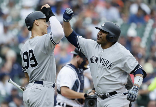 New York Yankees' Edwin Encarnacion, right, celebrates his two-run home run against the Detroit Tigers with Aaron Judge (99) during the third inning of the first game of a baseball doubleheader, Thursday, Sept. 12, 2019, in Detroit. (AP Photo/Duane Burleson)