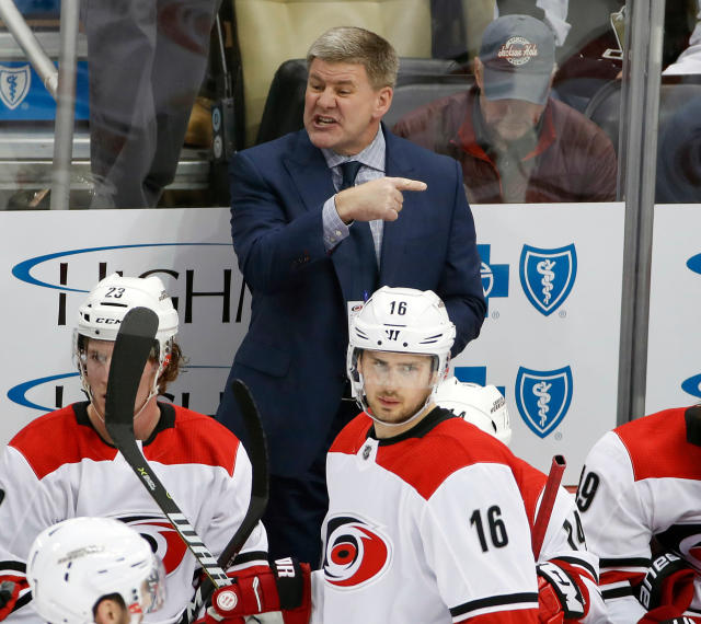FILE - In this Jan. 23, 2018, file photo, Carolina Hurricanes head coach Bill Peters gives instructions during the first period of an NHL hockey game against the Pittsburgh Penguins, in Pittsburgh. Peters has resigned as the Hurricanes coach after four seasons and no playoff berths. Peters announced his decision Friday, April 20, 2018, through the team, saying in a statement that this is a good time to move on. (AP Photo/Gene J. Puskar, File)