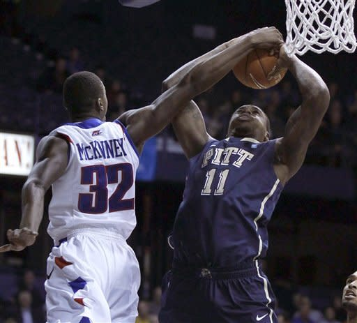 DePaul guard Charles McKinney (32) fouls Pittsburgh forward Dante Taylor during the first half of a Big East NCAA college basketball game on Thursday, Jan. 5, 2012, in Rosemont, Ill. (AP Photo/Charles Rex Arbogast)