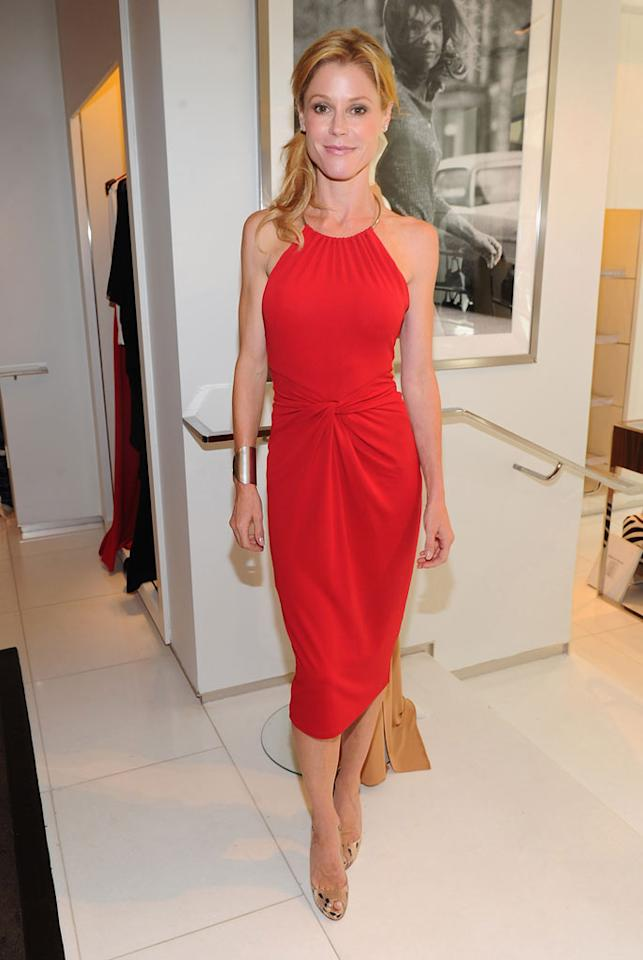 """Emmy winner Julie Bowen -- who took home the Outstanding Supporting Actress in a Comedy Series trophy for her work on """"Modern Family"""" -- turned heads in bright red at a charity event in Beverly Hills on Tuesday afternoon. The stylish mom of three perfectly paired a Michael Kors halter dress with Christian Louboutin peep-toes and a metallic cuff she bought in Mexico for a mere $20! Alberto E. Rodriguez/<a href=""""http://www.gettyimages.com/"""" target=""""new"""">GettyImages.com</a> - September 20, 2011"""