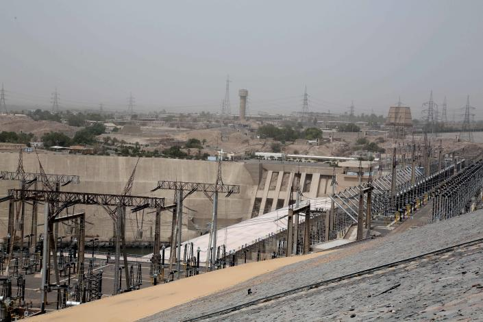 FILE - this May 7 , 2018 file photo, shows the high dam in Aswan, Egypt. Egyptians are marking 50 years since the inauguration of the Nile dam, a massive feat of construction that has shaped the course of modern-day Egypt. It spared it from seasonal droughts and flooding, and generated electricity, but it also displaced members of the country's Nubian minority and had a lasting environmental impact on the region. (AP Photo/Nariman El-Mofty, File)