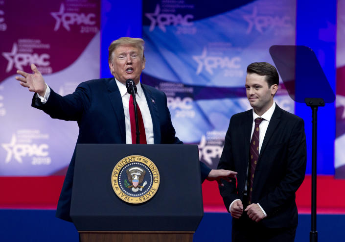 President Donald Trump invites to speak in the podium to Hayden Williams, a field representative of the Leadership Institute, who was assaulted at Berkeley campus speaks at Conservative Political Action Conference, CPAC 2019, in Oxon Hill, Md., Saturday, March 2, 2019. (AP Photo/Jose Luis Magana)